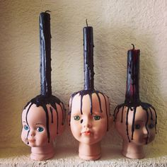 My babies! Haunted Halloween Decorations. Baby heads, doll heads, candles