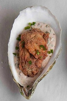 Fried Oysters with Spicy Rémoulade by Saveur. Chef Frank Stitt of Highlands Bar and Grill in Birmingham, Alabama, uses the bottom oyster shells as serving platters for these crispy fried oysters with piquant sauce.