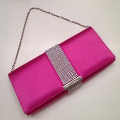 Dolce & Gabanna Pink satin clutch bling & shining Very very very very bling with loads if swarovski crystals. Have some stains on the cover but it does not really matter. Coz this bag is tooooo shining! Bought it for nearly $1000. Pink satin. You can put slim wallet, card case, phone lipstick to it. It is the perfect piece for the party or some special occasions. Silver tone chain. You can carry the bag as shoulder bag or as a clutch when take the chain off. Very hesitated to sell it. I…