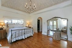 This bedroom's chandelier gives the space a romantic & ethereal vibe.