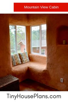 Graceful curves are showcased in this corner window seat that is part of this straw bale tiny house interior design. Straw bale building is sustainable and and very old technique - so grounding and beautiful.