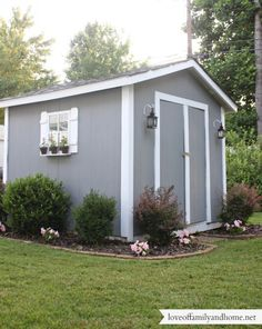Backyard Shed Decorating Ideas--cute shed, like the lanterns and the shutters