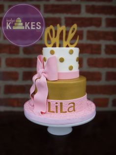 Pink And Gold Girly First Birthday Kake Top Cake Is Iced In Buttercream Bottom Tier Is Covered In Marshmallow Fondant Mmf Mmf Ribbons Bow And Topper