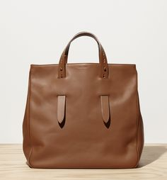 """leather tote bag with reinforced handles sturdy flat bottom and internal pockets 14"""" x 16"""" x 8"""" 100% leather made in Italy"""