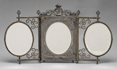 triptych type with two folding oval mirrors flanking central mirror in detailed openwork frame, standing cupid pediment, silver plate marks for Rogers & Co., patent date 1887, beveled mirrors, backs of mirrors with raised surface decoration with Asian style dragons within clouds, folding stand on back and hooks for hanging, 21-1/2 x 38 in. (open). One finial off but present, mirrors lacking most of silver plate