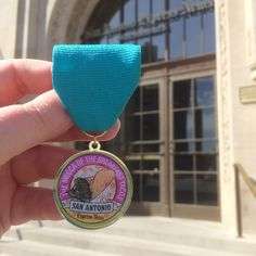 """The San Antonio Express-News' official Fiesta medal is on sale now.  The medal features a drawing of a taco, and proclaims San Antonio """"The Mecca of the Breakfast Taco,"""" eluding to the Taco War between the Alamo City and Austin that rocked social media earlier this year."""