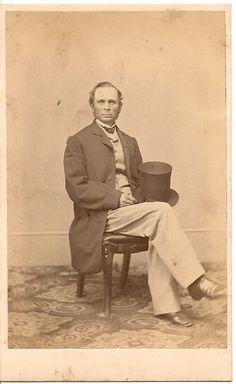 Light color vest, trousers; dark frock coat. Shown with shirt, tie, top hat.
