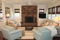 "quaint cottage in sea, sand and surf colors  {that brick fireplace is screaming ""whitewash me!"" }"