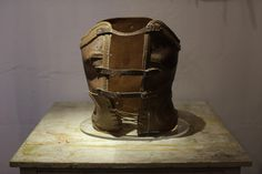 A leather corset that belonged to late Mexican artist Frida Kahlo is displayed at the Frida Kahlo museum in Mexico City, Tuesday, Oct. A full collection from Kahlo's wardrobe will go on p Leather Lingerie, Leather Corset, Frida And Diego, Mexican Artists, Diego Rivera, Style Icons, Leather Backpack, Personalized Items, Mexico City