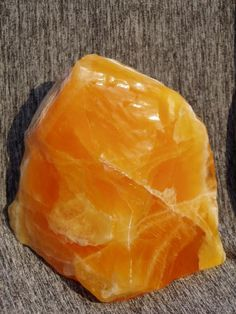 "Orange calcite can be used to promote de-calcification of bone growth; is known for assisting energy movement; moves ""stuck"" energies in the sacral chakra; is one of the most powerful and protective stones, giving energy whenever held to the body; helps integrate the four bodies (physical, emotional, mental, spiritual) through an understanding of how they work; is the happiness stone; helps heal sorrow and grief and ease tension; helps one feel joy, at peace with others, and connected to…"