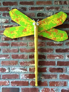 Landed in Melted Sherbet dragonfly creation from ceiling fan blades and repurposed table leg from Bombay table.  Complete with cabinet pulls and coat hook for antennae. Check out my other dragonflies at www.wingingthis.com
