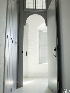 An interior doorway is elegantly arched.