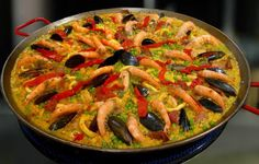 Dinner At Five - Mixed Paella for family of 8.  We deliver this item hot to your door.  If you will eat it later, we deliver it cold and ready for you to reheat.