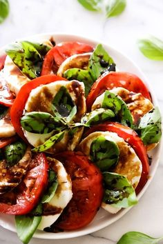A refreshing and light Caprese Salad comprised of tomatoes, mozzarella and basil. It is topped with an incredible Honey Balsamic Glaze that ties all the flavors together for an incredible meal, side dish or snack. Today is officially the first day of summer and what better way to bring it in than with a fresh …