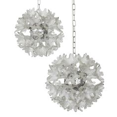 Italian floral Sputnik pendant chandeliers feature 33 textured Murano glass flowers on each example radiating from a central chrome hub.
