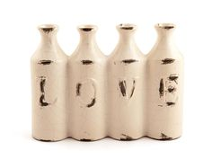ANTIQUED LOVE BOTTLE WHITE at R50 from Mr Price Home.