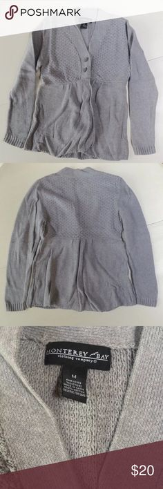 """Monterey bay cardigan gray knit sweater M This is a beautiful knit sweater in gray. It has two buttons for front closure and flares from the waist. M   Color is closest to third photo.  100% cotton machine wash lay flat to dry  Shoulder to shoulder: 15.5""""-19"""" Arm pit to arm pit: 18""""-24"""" Waist: 16""""-19"""" Sleeves: 24"""" Shoulder to hem: 25.5"""" Monterey bay Sweaters Cardigans"""