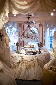 This gives me an idea for a table setting with layers of fabric lace and of course pearls swagged along the edge-BEAUTIFUL