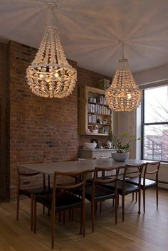 Not so much these fixture,s but I like the idea of double crystal chandeliers over a rustic table with the exposed brick walls.