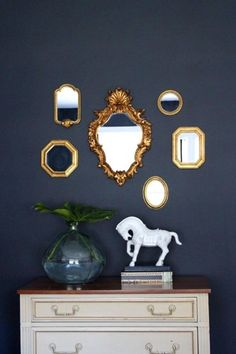 Mixed mirrors for the powder room downstairs?? I really love this look, and I already have the mirrors... Just  don't know where to put it in my house!