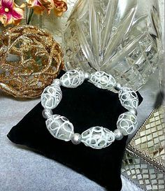 SALE Beautiful Large Oval Frosted Swirled Textured Glass Beaded Stretch Bracelet /Silver Round Beads Valentine's Day Designer FREE SHIPPING - Only $7.95 on Etsy! https://www.etsy.com/listing/97651475/sale-beautiful-large-oval-frosted