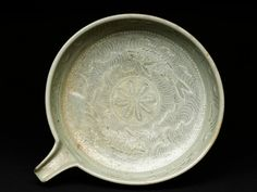 Bowl with flying birds and a seascape, Korea, 2nd half of the 14th century, Koryo Dynasty (AD 935 - 1392), stoneware, with inlaid slip decoration; 5 x 17.5 x 21 cm max. (height x width x depth). Bequeathed by Professor A. H. Sayce, 1933. EAX.1396 © Ashmolean Museum, University of Oxford