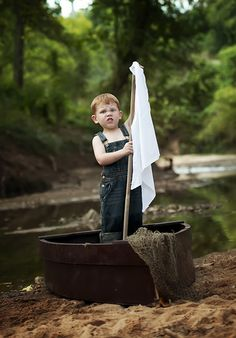 Little Boy preparing to set sail Amanda Valentine Photography