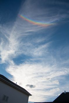Photographer: Manon Boily  Summary Authors: Manon Boily; Jim Foster  Shown above is a striking circumzenithal arc (CZA) as seen from Saint-Hubert, Quebec, Canada. I went outside to put my wet clothes on the washing line when I saw this colorful arc high in the sky as the Sun was approaching the horizon. Note that the red side of the arc is closest to the Sun. CZAs are the brightest of all the ice crystal halos and arcs.