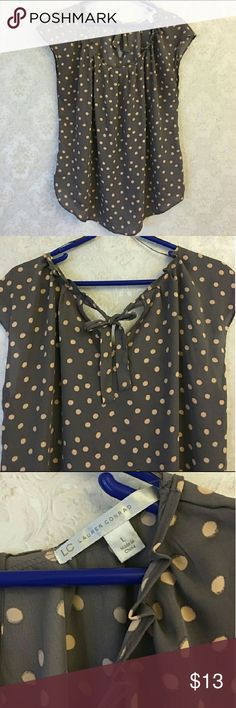 Lauren Conrad Blouse Gently used Lauren Conrad blouse. Size Large, grey with pink polka dots. Ties in the back. Very flowy and flattering! Smoke free home! LC Lauren Conrad Tops