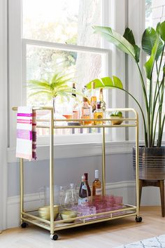 Bar carts serve as stylish yet hardworking hubs for entertaining. Learn how to style your beverage station with these beautiful bar cart ideas. #barcart #barcartstyling #barcartideas #barcartdecor #bhg Diy Bar Cart, Bar Cart Styling, Bar Cart Decor, Brass Bar Cart, Gold Bar Cart, Liquor Cart, Bar Cart Essentials, Outdoor Bar Cart, Cane Back Chairs