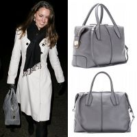 Kate has been spotted carrying a dove grey Tod' D-Styling bag on numerous occasions.  The bag is actually named after the late Princess Diana who owned an earlier version of this classic leather satchel.  Kate's version is called the D-Styling Medium Bauletto (Bowler) Bag in leather. It comes in several colour and size variations.