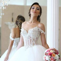 https://www.weddingsenchanted.com/collections/plus-size-wedding-dresses/products/vestido-de-noiva-a-line-v-neck-beaded-pearls-shortsleeve-tulle-wedding-dresses-2016-court-train-bridal-gowns