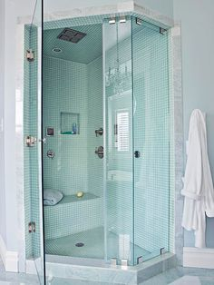 Set a walk-in shower into a small bathroom's corner, but expand the showering area by opting for a neoangled base and glass enclosure that step into the main bath area.