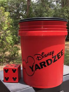 Disney YARDZEE! Great Family Game Cooler weather is on its way, whats a great way to spend some quality outside time with family and friends? Outside playing Disney YARDZEE. Play at home or take it on the go. Set includes 5 Giant dice made from cedar wood (each dice is just about 3.5x3.5 inches), score card (1), set of instructions, and 5 gallon bucket to store and travel with your Disney YARDZEE. Personalize with Family Name. ***All copyrights and trademarks of the character images used ...