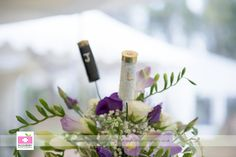 These bride and groom shotgun cartridges add interest to the table centre pieces at this woodland country wedding in North Yorkshire.  Photography from Razzleberry Photography.