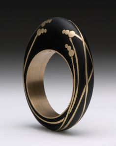Ring | Andrea Williams. 'Kebyar Sea Grass' Beach pebble inlaid with reclaimed/recycled 18k gold.  The gold shank reinforces the stone.