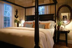 The Key West Master Bedroom at the Casa Grandview Historic Luxury Inn, Cottages and Suites located in West Palm Beach, FL.