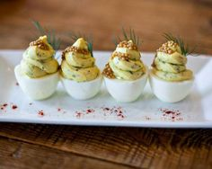 Yardbird Southern Table & Bars Deviled Eggs with Chives, Dill, and Caviar
