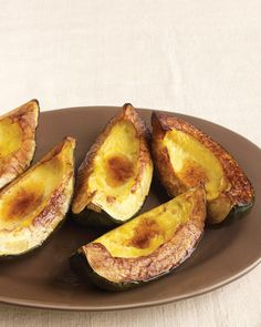 Roasted Acorn Squash with Cinnamon Butter  2 acorn squash (about 1 1/2 pounds each), unpeeled, quartered lengthwise, and seeded 1 tablespoon olive oil Coarse salt and ground pepper 4 tablespoons butter 1/8 teaspoon ground cinnamon
