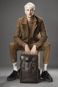 Ghurka backpack. Kent and Curwen's vicuna coat and N. Hoolywood's wool sweater and pants. [Photo by Rodolfo Martinez]