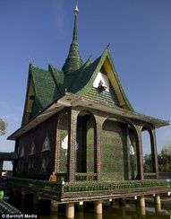 Buddhist temple made from recyled beer bottles