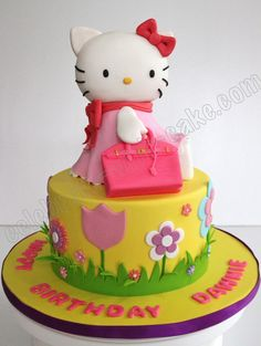 Millie, this Hello Kitty Cake is pretty!  It is a little silly, though!  Does Hello Kitty really have a pink purse, Millie?  Yes, No, or Maybe So?