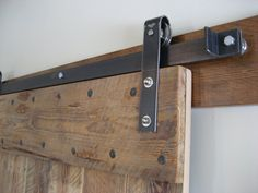 I would recommend this inexpensive barn door track, but with a top mount system.