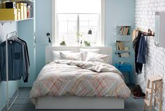 Small bedroom with IKEA double bed, clothes stand, shelves, hooks, mirror, lamps…