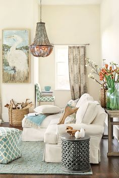 Comfy Family Room  ~ love the textures, neutrals, and soft blues.  The entire color pallet came from the painting on the wall.  Beautiful!