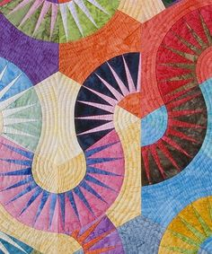 it is a diamond quilt where each diamond is paper foundation pieced: Curling Colours