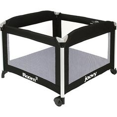 Joovy - Room2  Play-Yard, Black! Good for being able to put down activity mat and toys where dogs won't be able to get to her.