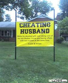Cheating husband sign in the front yard.....he SOoooo deserved it!