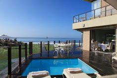 African Oceans Manor on the Beach Mossel Bay Featuring stunning, panoramic views over the Indian Ocean and the Outeniqua Mountains, this award-winning guesthouse offers a deck pool and large suites with patios. Gardens lead directly to Mossel Bay's beach. Beach Accommodation, Swimming Pool Decks, Outdoor Pool, Outdoor Decor, Wooden Decks, Private Pool, Weekend Getaways, Bed And Breakfast, Property For Sale