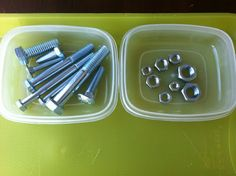 Matching up and screwing on the right Nut to fit the Bolt.  Fine motor working tray construction zone theme